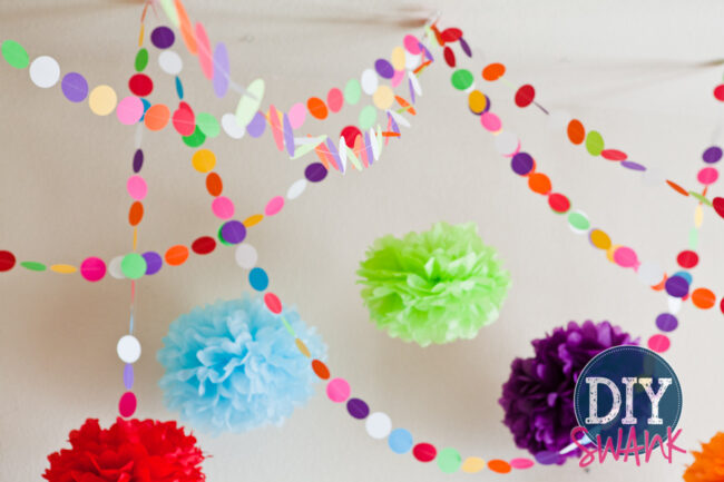 A tutorial on making DIY paper garland. Super easy, inexpensive decor idea for parties, baby showers or holidays!